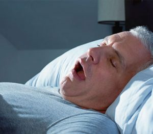 Man Snoring On Back